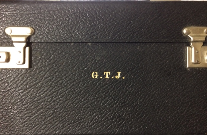 The monogrammed black case of promise and intrigue.